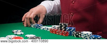 Croupier Bets With Chips On The Table In The Game Of Blackjack, Close-up