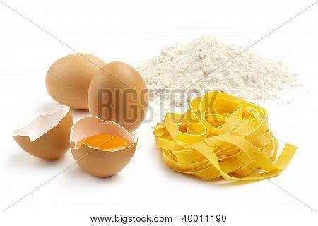 tagliatelle eggs and flour on white background