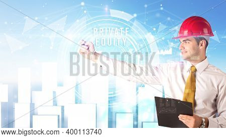 Handsome businessman with helmet drawing PRIVATE EQUITY inscription, contruction business concept