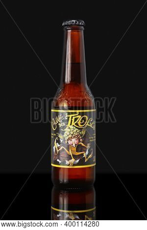 Paris, France - May 17 2020: Bottle Of Belgian Beer (cuvée Des Trolls) Isolated On Black Background.