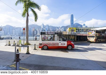 Hong Kong - November 2020: Mobile Softee Ice Cream Truck Parked Next To Coconut Tree, Kowloon. Mediu