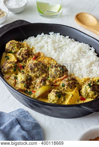 Meatballs With Rice, Curry Sauce, Lime And Red Pepper. Healthy Eating.