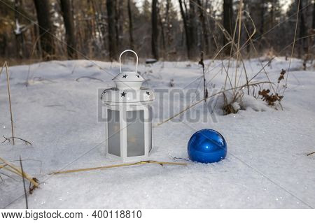 Christmas Landscape Of The Forest And Still Life With A Christmas Tree Blue Ball And A White Candle-