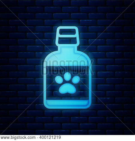 Glowing Neon Dog Medicine Bottle Icon Isolated On Brick Wall Background. Container With Pills. Presc