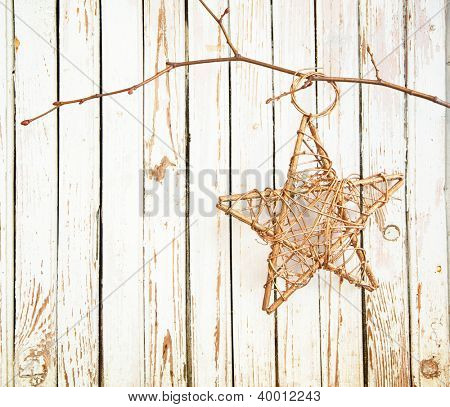 christmas decoration hanging over  old wooden board