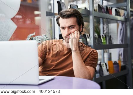 Stressed Manager Worried About Documentation On Laptop