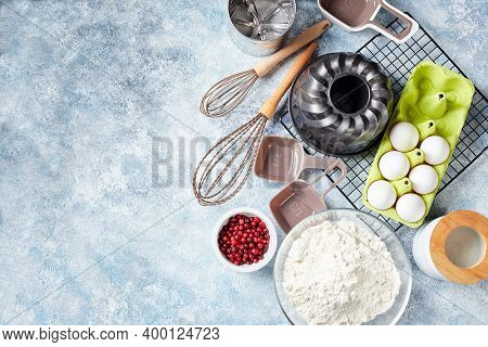 Baking Ingredients And Utensils, Flour, Eggs, Baking Dish On Light Background