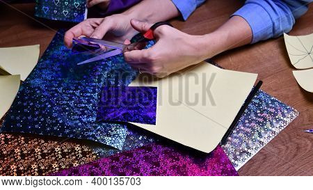 Woman Hands Cut Craft Paper With Scissors. Diy Craft Project Making With Glittering Craft Papers And