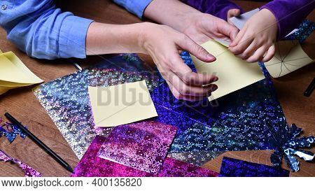 Craft Project Making Hands Of Woman And Toddler Kid. Crafting With Glittering Craft Papers And Sciss