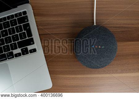 London, United Kingdom - 19 December 2020: Charcoal Google Nest Home Mini Smart Speaker With Built-i