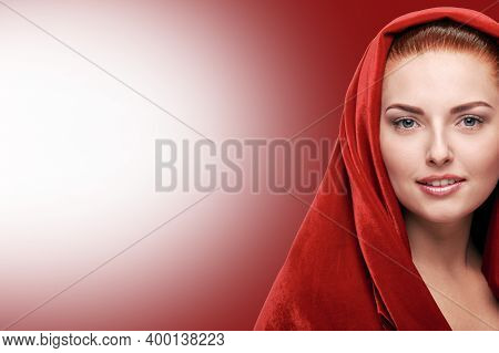 Portrait Of Beautiful Young Woman Wearing Red Shawl On Head