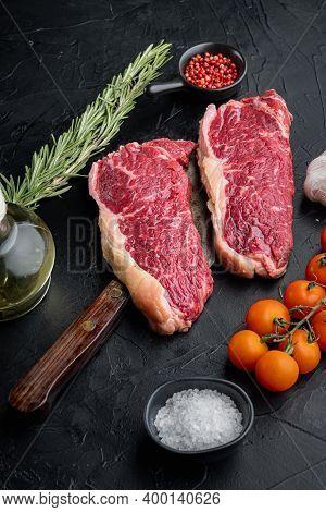 Short Loin Raw Beef Steak, On Black Background