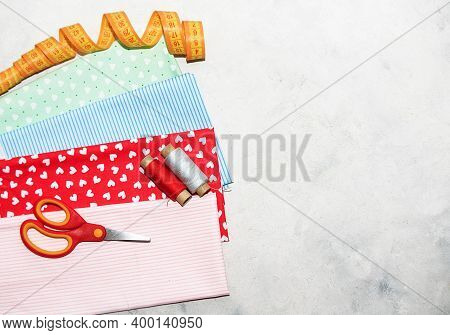 Sewing Tools And Multi Color Fabric On A White Background. Concept For Needlework, Stiching, Embroid
