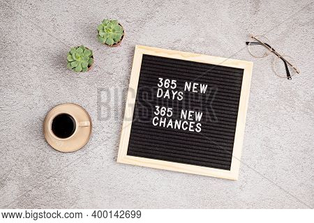365 New Days, 365 New Chances. Letter Board With Motivational Quote On Grey Concrete Background With