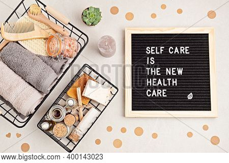 Self Care Is The New Health Care. Motivational Quote On Black Letter Board With Variety Of Organic B