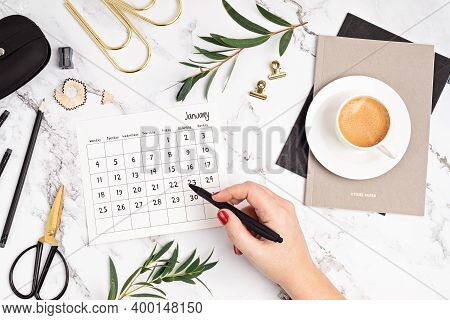 Desktop With Calendar For January And Office Supplies. Home Office, Social Media Blog, Schedule, Pla