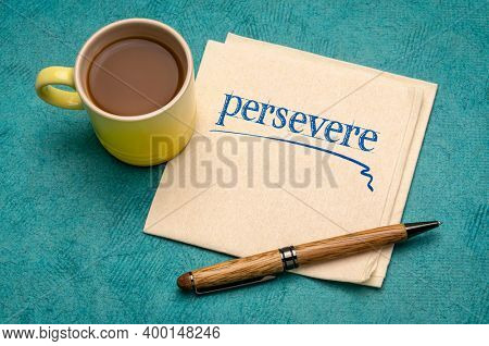 persevere motivational note - handwriting on a napkin with a cup of coffee, perseverance and determination concept