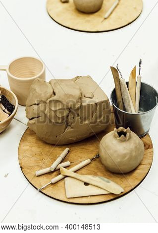 Sculpting Tools Set And Clay On Table.