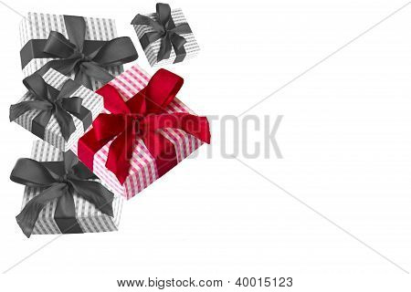 Corner: black and white and red giftboxes on white background