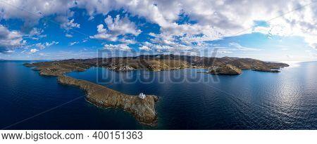 Greece, Kea Tzia Island. Lighthouse On Rocky Cape, Sky, Sea Background. Panorama.