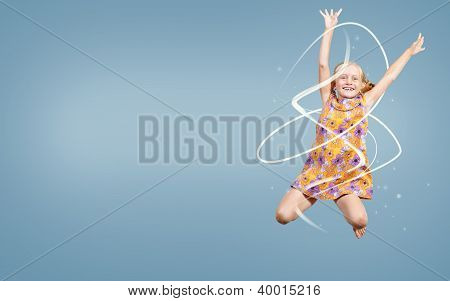 girl jumping hands up