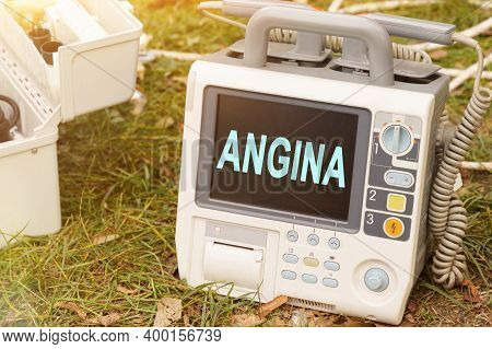 Medicine And Health Concept. The Text Is Written On The Defibrillator Monitor - Angina