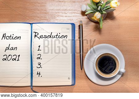 2021 New Year Resolution Goal List - Desk With Notebook Written In Handwriting About Plan Listing Of
