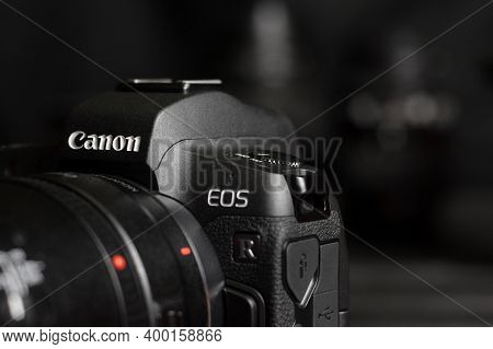 Canon Eos R Photocamera With Canon Lenses On Black Table. Canon Eos R Is 30mp Full-frame Mirrorless