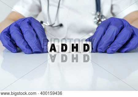 Medicine And Health Concept. The Doctor Put Together A Word From Cubes Adhd. Attention Deficit Hyper