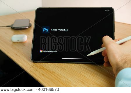 Adobe Photoshop Is Used With Apple Pencil On Ipad Pro Tablet . Man Using Application On The Tablet.