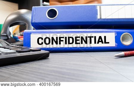 Inside Of A Filing Cabinet With Green Folders And Focus On Confidential Label.