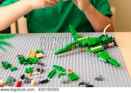 Saint-petersburg, Russia - November 29, 2020 Hands Of The Child Collecting The Conductor Lego Accord