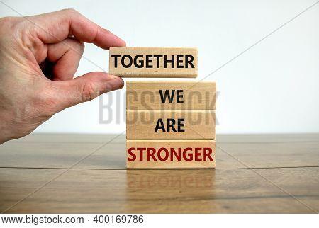 Together We Are Stronger Symbol. Wooden Blocks With Words 'together We Are Stronger'. Male Hand. Bea