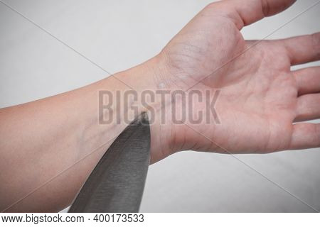 A Hand Of A Woman Attempting To Commit Suicide, She Wants To Cut Her Veins With A Kitchen Knife