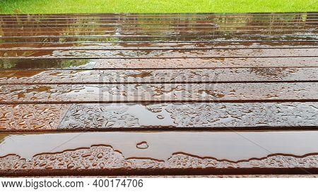Timber Deck after rain, wet timber decking, Australian spotted Gum timber decking, close up, wet weather
