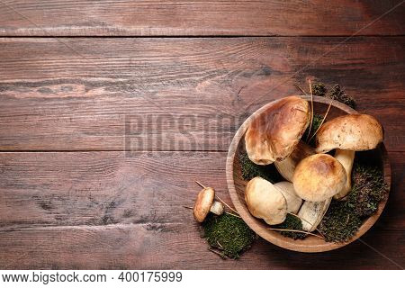 Fresh Wild Porcini Mushrooms On Wooden Table, Top View. Space For Text