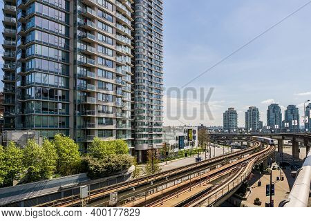 Vancouver, Canada - April 14, 2020: Skytrain Rapid Transit System Elevated Rail Road In Downtown
