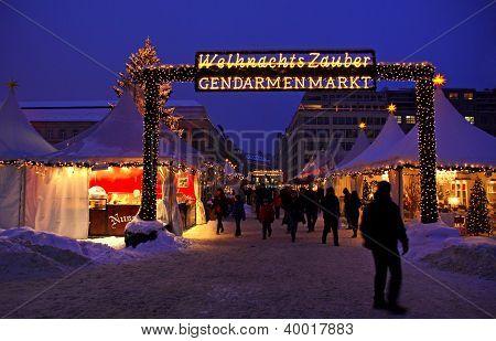 People Walking During Christmas Market At Gendarmenmarkt Square In Berlin, Germany
