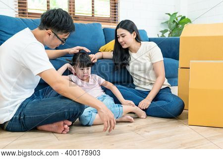 Candid Of Young Parents Teach, Care And Coach Little Daughter With Positive Behavior In Child Anger