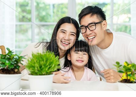 Portrait Of Young Cute Asian Family Three People At Home Smiling Happy Positive To Camera In Parenth