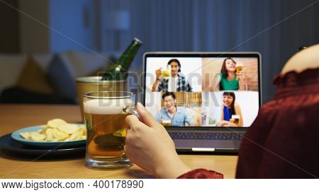 Young Happy Asian Couple Enjoy Relax Night Party Event Online Celebration Festive With Friends At Ho