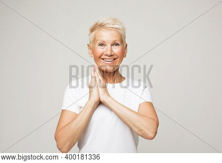 lifestyle, emotion and people concept: elderly surprised woman.