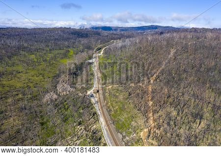 Aerial View Of A Train Line Running Through And Area Of Forest Regeneration After Bushfire In Dargan