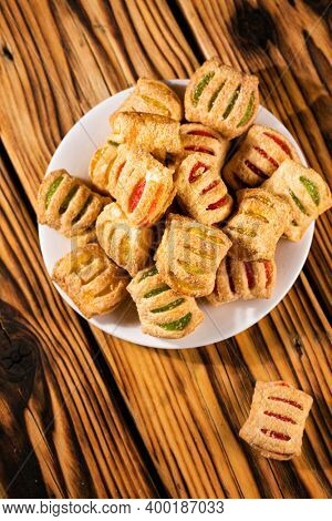 cookies from puff pastry with colored jam