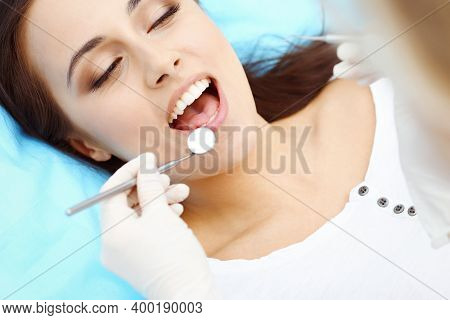Young Female Patient Visiting Dentist Office.beautiful Woman With Healthy Straight White Teeth Sitti
