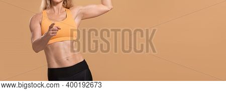 Challenge, Choice, Body Care In Middle Age. Muscular Confident Female Coach In Sports Uniform Shows