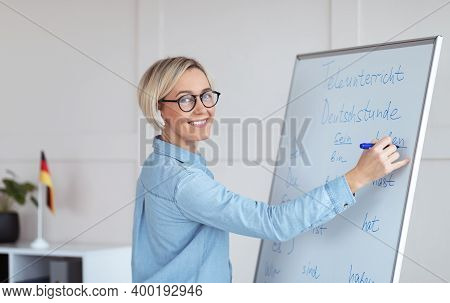 Experienced Foreign Languages Tutor Teaching German Lesson, Writing Down Grammar Rules On Blackboard