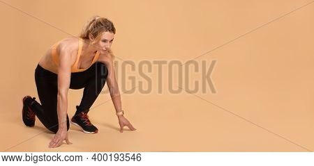 Cardio Workout And Morning Jog For Body Care. Adult Slender Female Coach In Sportswear With Fitness