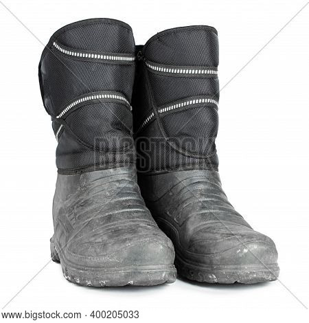Dirty Insulated Old Boots On A White Background. Hiking Boots.