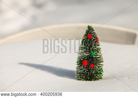 Christmas tree on snow  with red and green decor with copy space